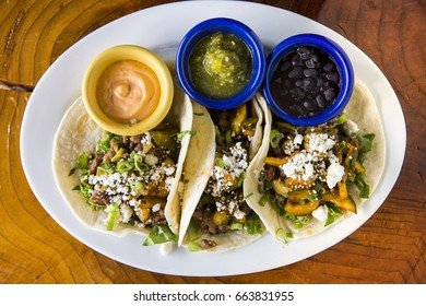 Fresh Crispy Mexican Tacos with Corn Tortilla, Beans, Vegetables and Cheese and Salsa