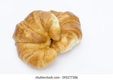 Fresh croissant on white background.