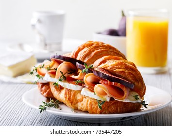 Fresh Croissant Sandwich with  Ham, Cheese, Thyme and figs Breakfast Delicious Baking  Refreshment