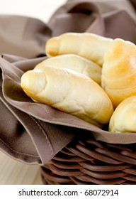 fresh croissants in a basket with napkin