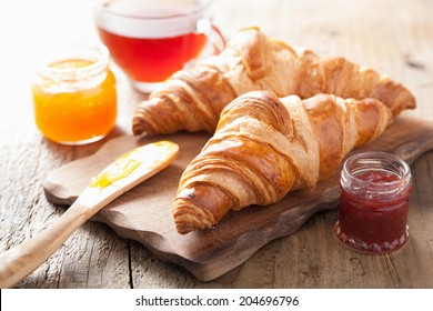 fresh croissants with jam for breakfast