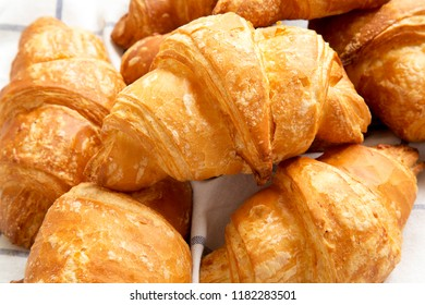 Fresh croissants on cloth, close-up.