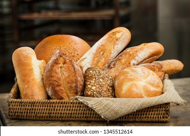 Fresh crunchy bread assortment in a cozy wicker basket