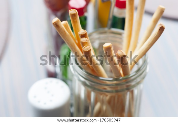 fresh and crunchy breadsticks on the table in restaurant