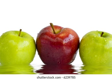 Fresh crunchy red and green apples with water droplets