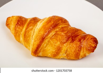 Fresh crust croissant in the plate