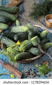 Fresh cucumbers in a bowl on vintage wooden  table.  Healthy eating concept. Vegetarian food. vegetables background