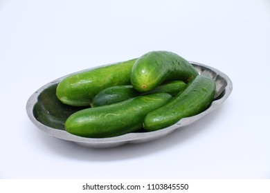 fresh cucumbers on the plate isolated