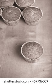 Fresh cupcake desert before decoration. Selective focus. Toned.