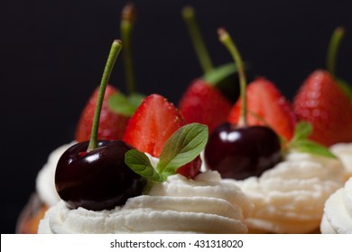 Fresh cupcakes with cream and berries. Shallow depth of field. Selective focus.