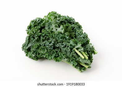 Fresh Curly green kale on white background