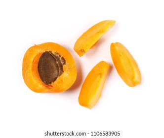 Fresh cut apricot fruit slices isolated on white background, top view