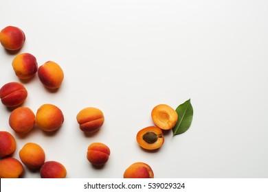 Fresh cut apricot fruits on white background