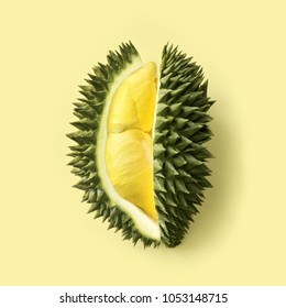 Fresh cut durian on a pastel yellow background, king of fruit from Thailand