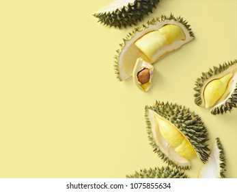 Fresh cut durian on a pastel yellow background, king of fruit from Thailand, creative food concept