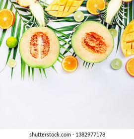 fresh cut Exotic fruits tropical leaves on a white background, space for text, top view flat lay