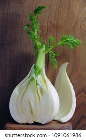 Fresh cut fennel in front of the wooden background