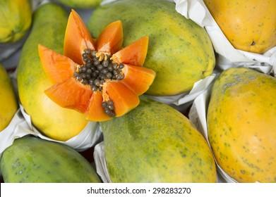 Fresh cut juicy tropical papaya fruit with seeds at Brazilian farmers market in Rio de Janeiro Brazil