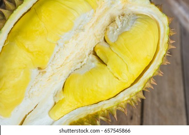 Fresh Cut Kanyao Durian on wooden background,a close-up view of Durian Yellow durian inside Mon Thong durian, King of fruit.