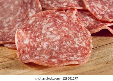 Fresh Cut Organic Salami against a background