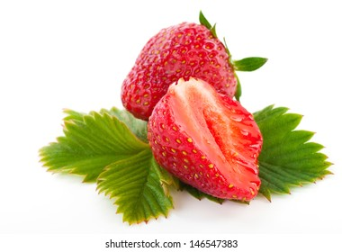 fresh cut strawberry with leaf isolated on white