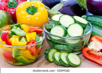 Fresh cut vegetables in glass bowls.