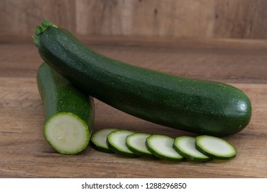 Fresh cutted zucchini isolated on a wooden background.