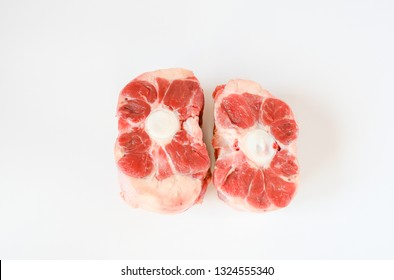 Fresh cutting raw oxtail or beef with bone, tail path of cow on  white background. Oxtail is a gelatin-rich meat, which is usually slow-cooked as a stew.