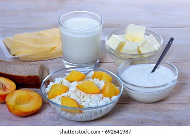 Fresh dairy product with peaches on table