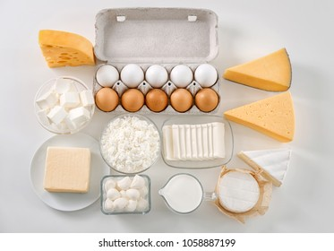 Fresh dairy products and eggs on white background