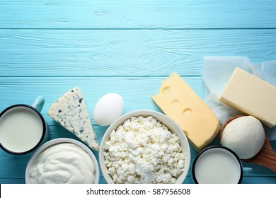 Fresh dairy products on blue wooden background