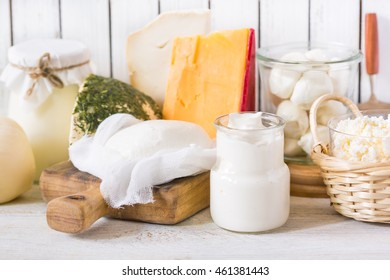 Fresh dairy products on old kitchen board. Rustic style.