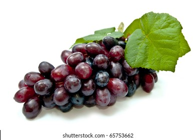 Fresh dark grape with leaves. Isolated on white
