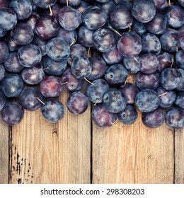 Fresh Dark Plums on Wooden Table, Above View