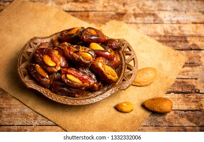 Fresh date fruits with almonds on a table