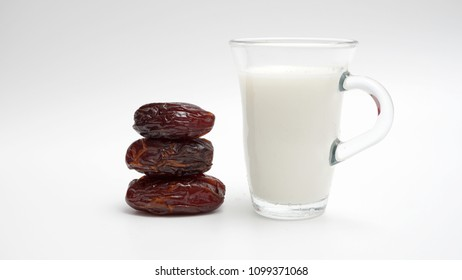Fresh dates and milk. A sunnah food for muslim around the world to break fast. Isolated white background