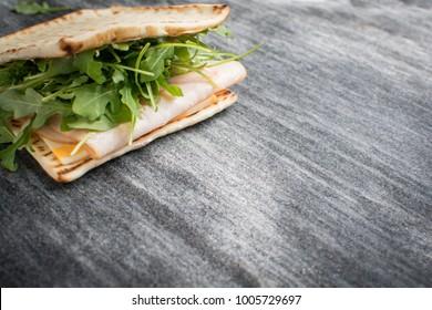 A fresh deli sandwich on a granite counter.