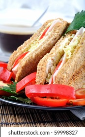 fresh and delicious classic club sandwich over a black glass dish with coffee and vegetable