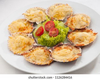 fresh and delicious dish of scallops baked with cheese in its shell