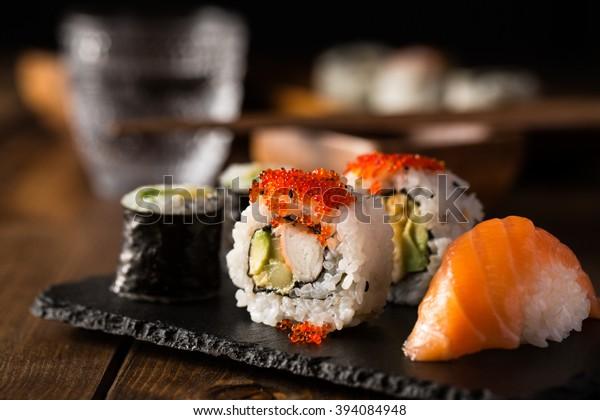 Fresh and delicious maki and nigiri sushi and sake glass.