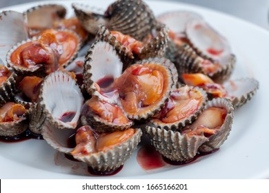 Fresh and delicious boiled cockles shell with spicy seafood sauce, thai food.