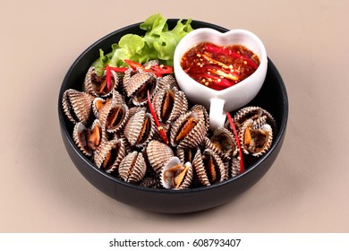 Fresh and delicious soft-boiled blood cockles shell  served with spicy sauce  in Korea pattern black dish