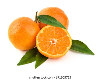 Fresh delicious whole and cut mandarins on branch with green leaves on white background