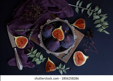 Fresh and delicous figs isolated on dark background