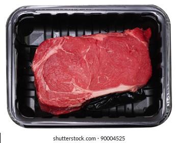 Fresh delmonico or rib eye steak isolated on white in black package