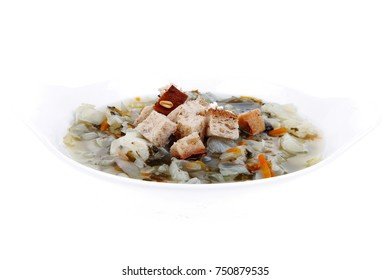 fresh diet vegetable soup with rye bread crackers isolated over white background