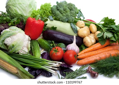 A lot of fresh, different vegetables on white.