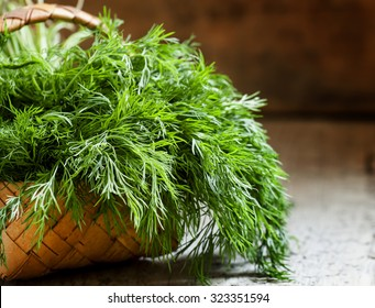 Fresh dill from the garden on the old wooden table in rustic style, selective focus