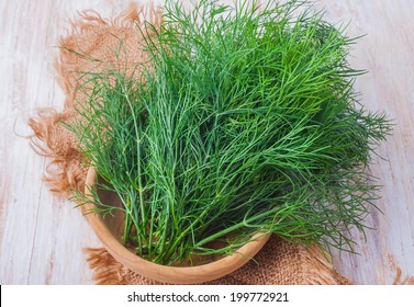 fresh dill on wooden table