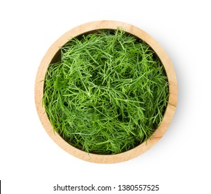 Fresh dill in wood bowl isolated on white background. top view